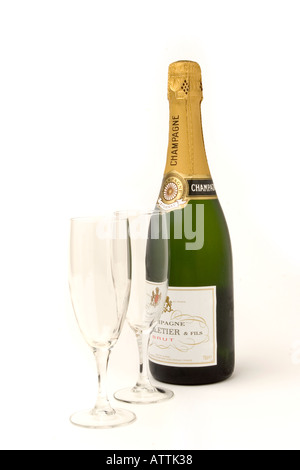 drink unopened bottle of champagne with two flute glasses - Stock Photo