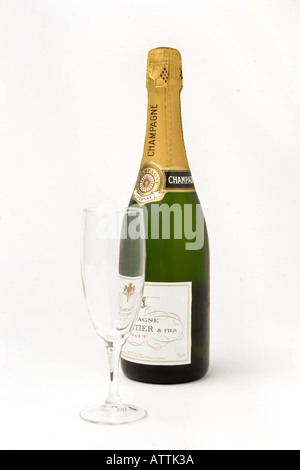 drink unopened bottle of champagne with one flute glass - Stock Photo