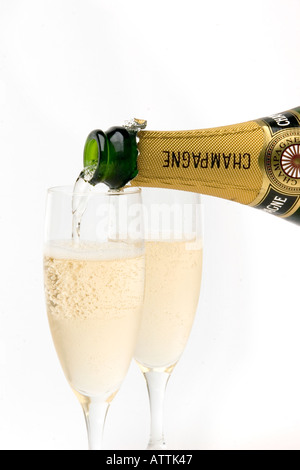 drink pouring two glasses of champagne - Stock Photo
