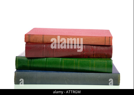 Four old faded and stained books in a pile isolated on a white background - Stock Photo