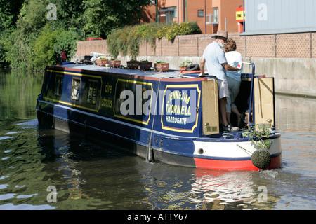 narrowboat from rear drifting along nottingham canal nottingham england - Stock Photo