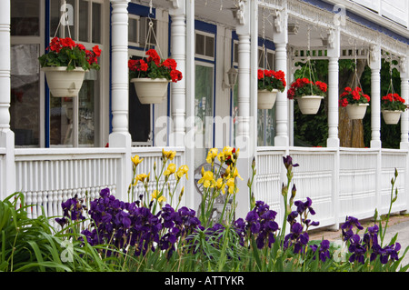 Victorian Front Porch With Potted Hanging Plants Stock Photo 13161053