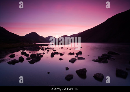 Stunning sunrise over Yew Barrow, Great Gable and Lingmell in Wast Water in the Lake District - Stock Photo