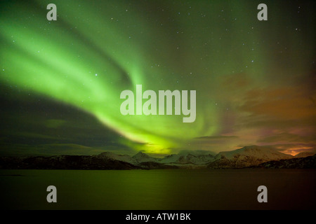 Spectacular Aurora Borealis (Northern Lights) over Sommarøy, Norway - Stock Photo