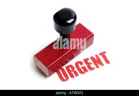 URGENT rubber stamp - Stock Photo