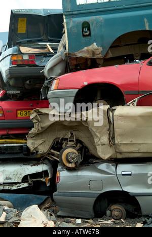 stack of cars in breakers yard - Stock Photo