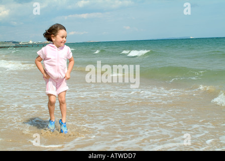 a girl jumping over waves - Stock Photo