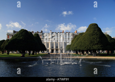 View across a fountain in the East Gardens towards the East Front of Hampton Court Palace, Richmond Upon Thames, - Stock Photo