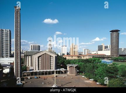 Holy Trinity Roman Catholic Cathedral with tower of Kenyatta International Conference Centre on right Nairobi Kenya - Stock Photo