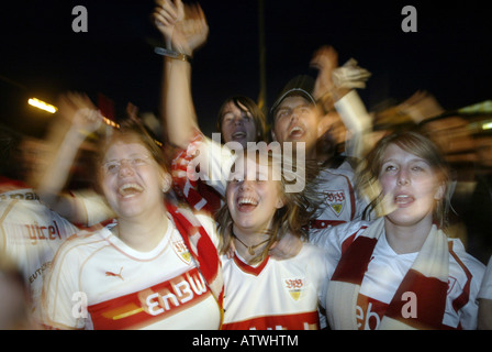 Supporters of the German soccer team VfB Stuttgart celebrating the German Cup final - Stock Photo