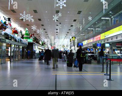 Christmas Travellers Dublin Airport Ireland - Stock Photo