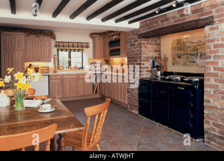 Domestic interior, traditional kitchen diner with aga cooker and beamed ceiling - Stock Photo