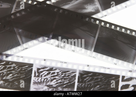 Close up view of black and white film negatives showing desert scenes - Stock Photo