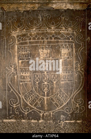 Very old royal coat of arms engraved outside tomb Inside the Sé Lisbon - Stock Photo