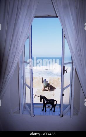 Morocco La Maison des Artistes window in hotel Essaouira - Stock Photo
