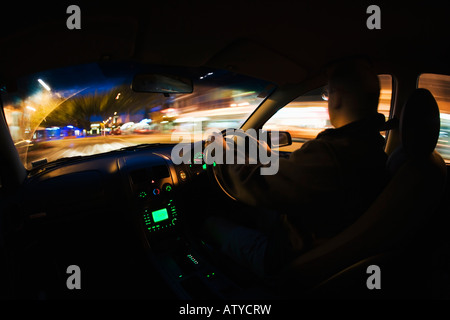 Night Drive Holden Commodore 2003 model at night in New Zealand - Stock Photo