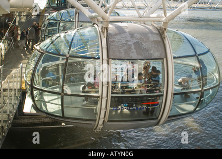 Horizontal close up of a group of children inside a capsule of the London Eye 'Millennium wheel' on a bright sunny - Stock Photo