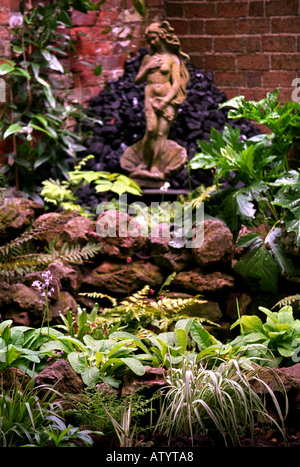 A ROCKERY WITH A STATUE OF VENUS IN THE STYLE OF BOTTICELLIS BIRTH OF VENUS - Stock Photo