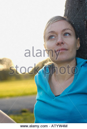 Woman sitting outdoors in a park - Stock Photo