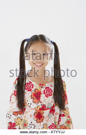Young girl indoors looking at camera - Stock Photo