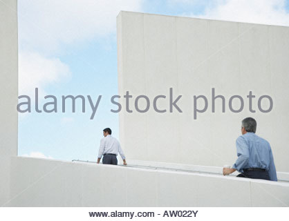 Two businessmen walking up an outdoor staircase - Stock Photo