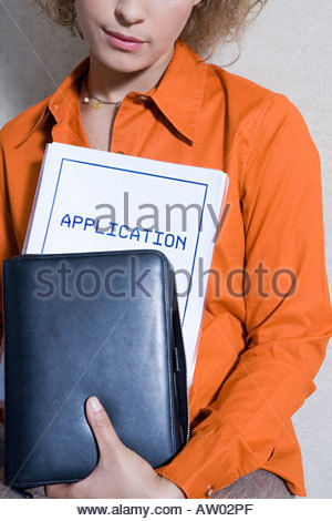 Women with application form - Stock Photo