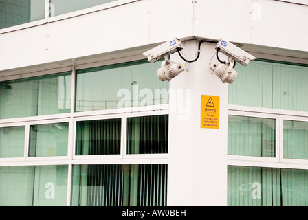 CCTV Cameras on corner of an office building - Stock Photo