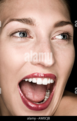 close up of happy looking woman - Stock Photo