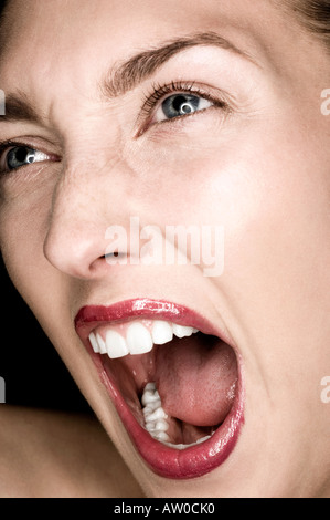 close up of young woman shouting - Stock Photo