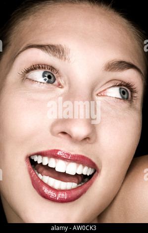 close up of innocent looking young woman - Stock Photo