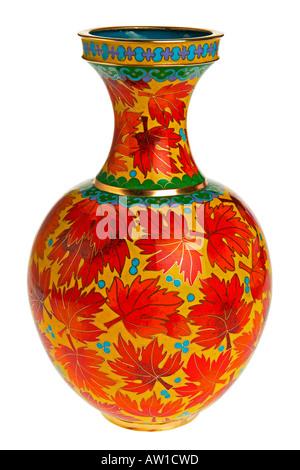 Cloisonne enamel ware vase 25cm high with maple leaf design against white background JMH1954 - Stock Photo