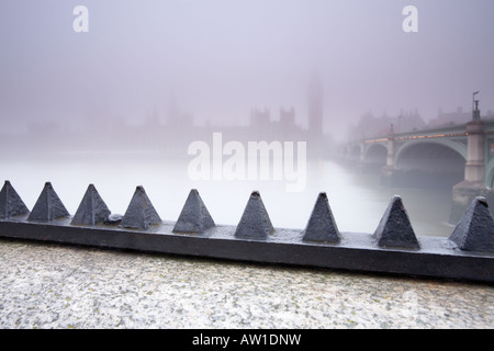 Looking across the Thames river towards the Houses Of Parliament from Albert Embankment London city England UK - Stock Photo