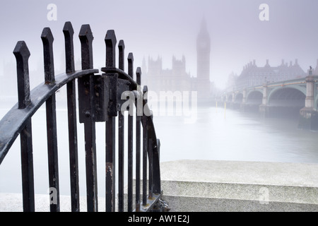 Dawn fog from Albert Embankment across the Thames River to the Houses of Parliament and Big Ben London city England - Stock Photo