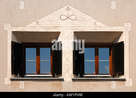 Window view of anl Engadine house decorated with Sgraffito ornaments Samedan Engadin Grisons Switzerland - Stock Photo