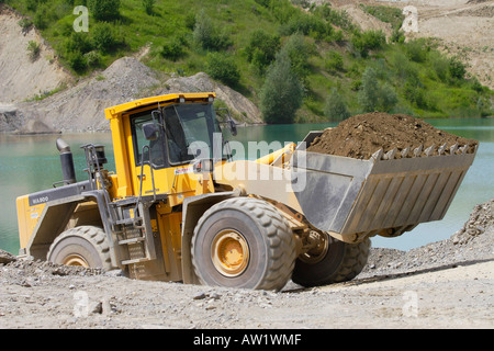 Mechanical shovel excavator in a gravel pit - Stock Photo