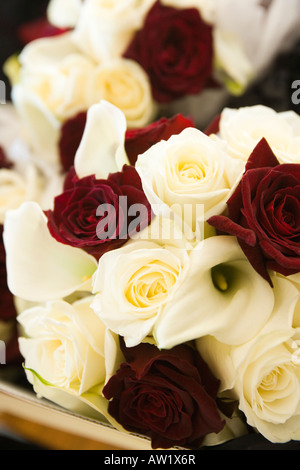 dark red and cream roses - wedding bouquets - Stock Photo