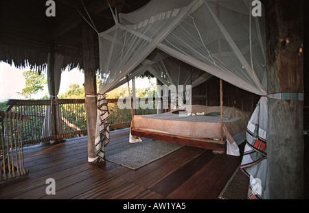 Interior of one of the elevated luxury treehouses built around a giant boabab tree at Chole Mjini eco lodge Chole - Stock Photo