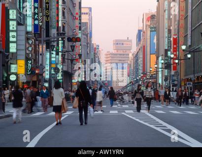 People walking on main street of Ginza in Tokyo Japan - Stock Photo