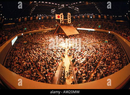 Sumo wrestling ring under Shinto shrine roof in Tokyo stadium - Stock Photo