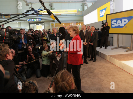 CeBIT 2008 - German chancellor Angela Merkel talks to journalists at the stand of the German software maker SAP - Stock Photo