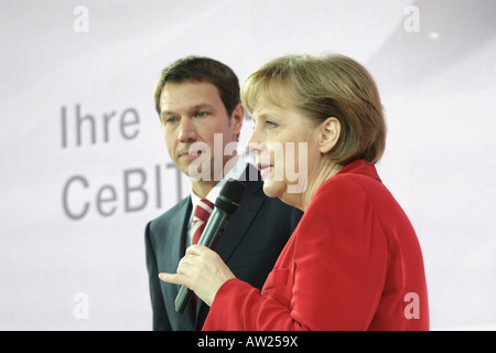 CeBIT 2008 - German chancellor Angela Merkel stands next to Deutsche Telekom CEO Rene Obermann - Stock Photo