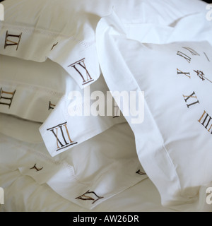 pillowcases hand embroidered with clock face and Roman numerals - Stock Photo
