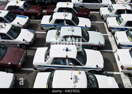 Line of Taxis outside train station in Sendai, Japan - Stock Photo