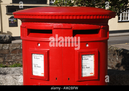 Red British post box with two slots. - Stock Photo