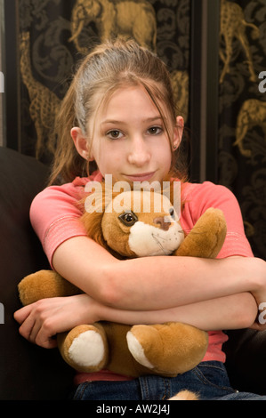young girl posing, playing with travel things - Stock Photo