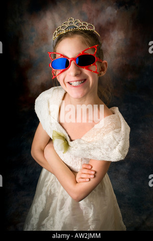 young girl playing dress up with funky glasses - Stock Photo