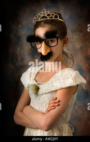 young girl playing dress up with mask or disguise - Stock Photo