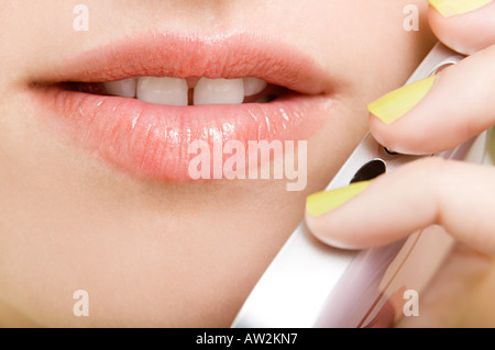 Woman using a cellular telephone - Stock Photo