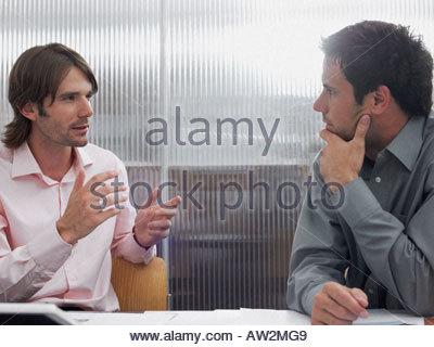 Colleagues having a conversation - Stock Photo