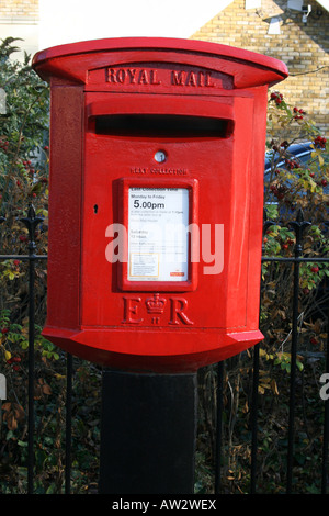 Modern Royal Mail red lamp post box in Oxford - Stock Photo